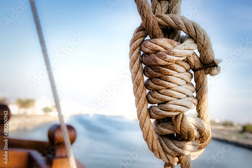 Photo Stands Ship Ancient ship rope forming a sailor knot.