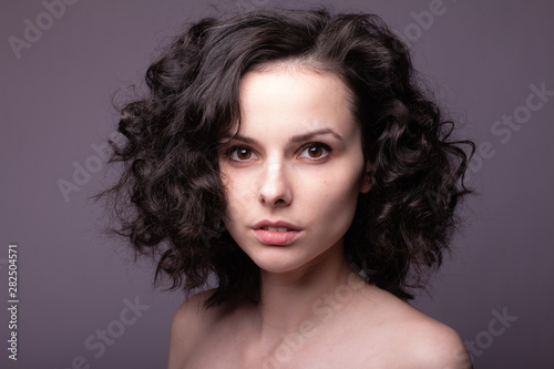 Recess Fitting Hair Salon beautiful young curly girl close-up portrait