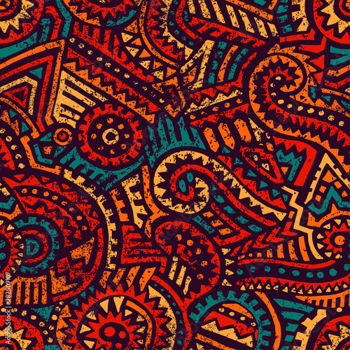 Foto auf AluDibond Boho-Stil Seamless african pattern. Ethnic and tribal motifs. Orange, red, yellow, blue and black colors. Grunge texture. Vintage print for textiles. Bohemian hand-drawn ornament. Vector illustration.