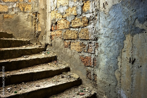 old dirty staircase in abandoned building closeup.