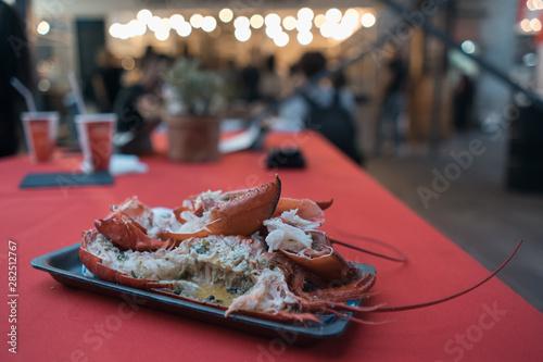 Fotografie, Tablou fresh red boiled lobster in paper plate on food festival