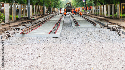 Photo sur Toile Voies ferrées laying of rails of tramroad on concrete sleepers