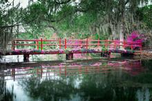 Red Bridge With Blooming Flowe...