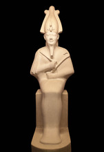 Statue Of Osiris Isolated On Black. He Was Son Of Ra, Lord Of The Dead And Rebirth, God Of Fertility In Ancient Egypt.