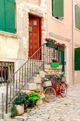 Fototapety, obrazy: One of the narrow back streets in the historic old town of Rovinj in Croatia