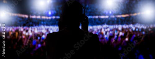 Fotografija Dj with headphones mixing on a stadium
