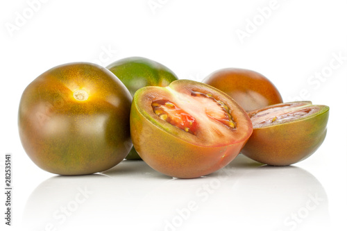 Photo  Group of three whole two halves of fresh greenish red tomato isolated on white b