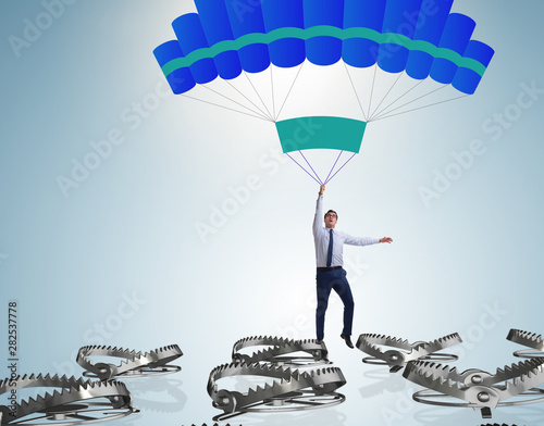 Stampa su Tela Businessman falling into trap on parachute