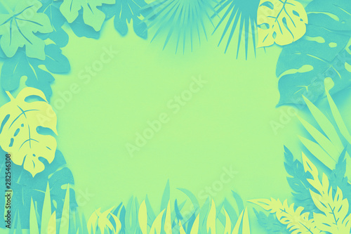 Poster de jardin Montagne Dark floral background with paper tropical leaves