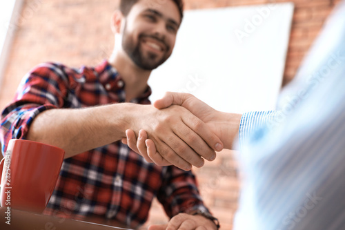 Business partners shaking hands after meeting, closeup Canvas Print