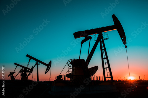 Fototapeta In the evening oil field, the pump is running. obraz