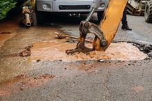 Splatter Of Water From Broken Pipe The Main Road