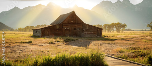 Fotografie, Obraz Classic old barns in the Teton Mountains, Wyoming, USA