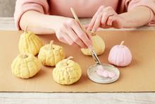 Woman Paints Miniature Pumpkin...