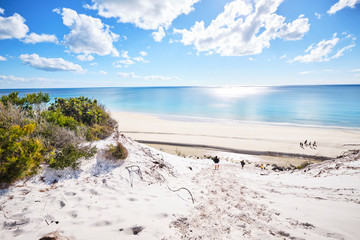 White sand dune with people on Fraser Island