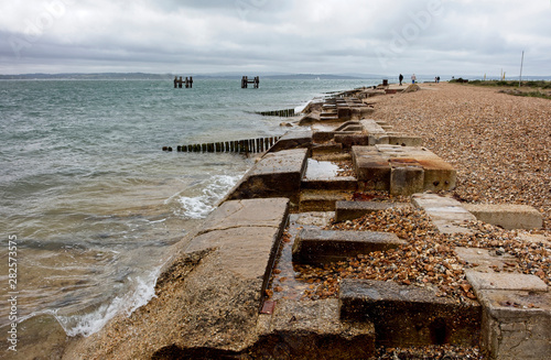 Fotografia  Ruins of the quay for loading landing craft for the historic D-Day landings of W