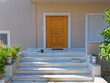 Athens Greece, cat on the stairs of contemporary house entrance