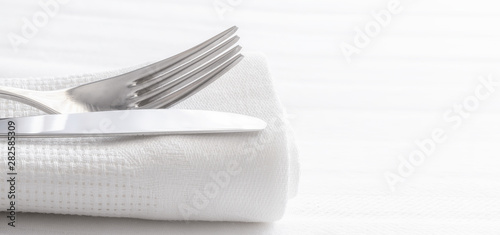 Fotografie, Obraz  Close up of silverware fork and knife with napkin