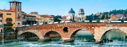 Roman arch bridge over Adige River in Verona. Historical center of European city. Romantic sightseeng trip to Italy
