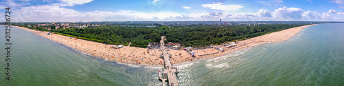 Obraz Summer beach panorama with wooden pier at Baltic Sea in Gdansk, Poland. - fototapety do salonu