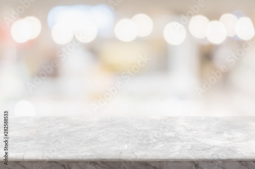 Canvas Prints Countryside Empty white marble stone table top and blurred restaurant interior background - can used for display or montage your products.