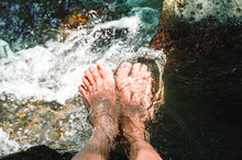 Men Feets In A Stream Of Water...
