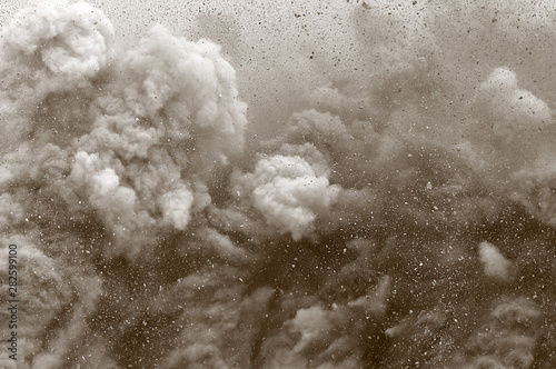 Leinwand Poster Rock particle and dust clouds after detonator blast