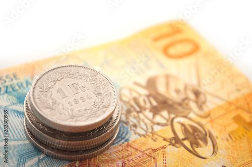 Valokuva  Coins and bank note of Switzerland on white background