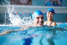 Female Swimming Teacher Giving...