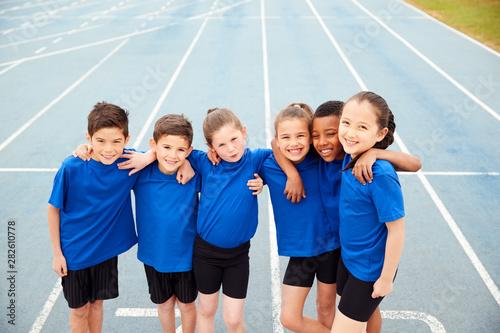 Obraz na plátně  Portrait Of Children In Athletics Team On Track On Sports Day