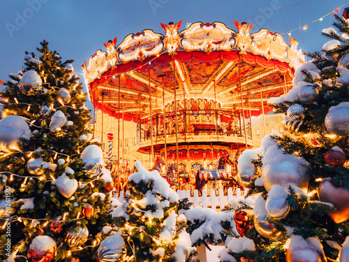 Fotografie, Obraz  Beautiful brightly glowing carousel on the Red Square decorated and arranged for Christmas and New Year