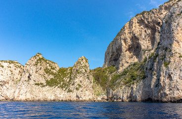 Italy, Capri, view of the coast seen from the sea.
