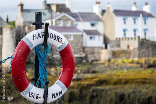Fototapeta A lifebuoy, ring buoy, lifering, lifesaver, life donut, life preserver or lifebelt is a life saving buoy