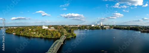 Canvas Prints Night blue Skyline von Berlin mit Blick auf den Stadtteil Spandau und den Fernsehturm sowie die Zitadelle, den Teufelsberg, das Olympiastadion und eine Brücke auf eine Insel (Eiswerder)