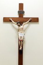 Statue With Image Of Crucified Jesus