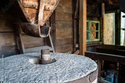 The ancient old stone grain mill gristmill grinding wheat or grains into flour u Canvas Print