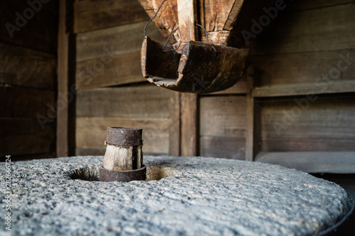 Photo  The ancient old stone grain mill gristmill grinding wheat or grains into flour u