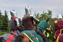 Group Of Medieval Knight On Moving Horses. Historical Reenactment In Brodnowski Park In Warsaw, Poland