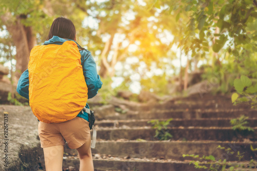 Foto auf Gartenposter Melone Girl travelers climb up the mountain, traveling adventure concept in the summer.