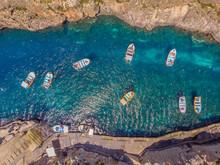Blue Grotto In Malta. Pleasure Boat With Tourists Runs. Aerial Top View