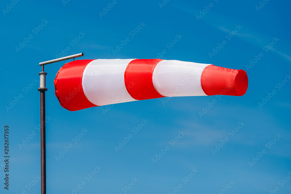 Fototapeta Windsock indicator of wind on runway airport