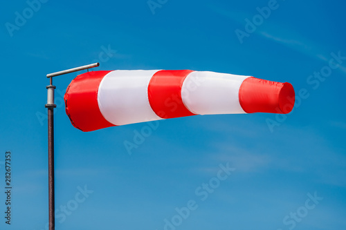 Fotografia  Windsock indicator of wind on runway airport