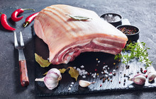 Raw Pork Belly With Skin On A Slate Tray