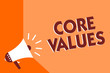 Conceptual hand writing showing Core Values. Business photo text belief person or organization views as being importance Megaphone loudspeaker orange background important message speaking