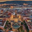 Budapest, Hungary - Aerial drone view of the famous illuminated St.Stephen's Basilica (Szent Istvan Bazilika) at blue hour. Buda Castle, Szechenyi Chain Bridge and Fisherman's Bastion at background