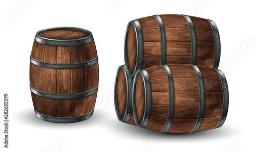 Photo Four wooden barrels for wine or other drinks, studded with iron rings on a white background