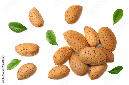 Cuadros en Lienzo almonds with green leaves isolated on white background. top view.
