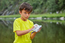 Young Vandal Washes A Parent Smartphone.