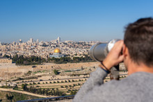 Man Watching The Old City Of Jerusalem With A Binocular