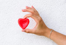 Woman Hand Holds Red Heart
